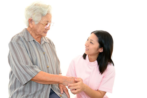 Genki HomeCare caregiver holding hands with client
