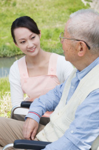 Genki HomeCare caregiver and senior in wheelchair
